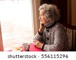lonely senior woman sitting and ... | Shutterstock . vector #556115296