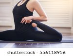 young asian woman doing yoga... | Shutterstock . vector #556118956