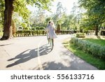 couple with tandem bicycle.... | Shutterstock . vector #556133716