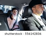 businesswoman riding a car with ... | Shutterstock . vector #556142836