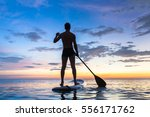 silhouette of stand up paddle...