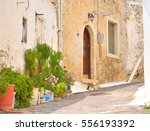 the narrow street with old... | Shutterstock . vector #556193392