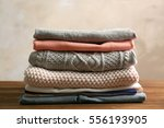 pile of clothes on table | Shutterstock . vector #556193905