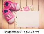 it s a girl card. pink shoes... | Shutterstock . vector #556195795