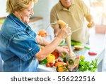 senior couple cooking healthy...   Shutterstock . vector #556222516