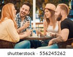 friends having a great time in... | Shutterstock . vector #556245262