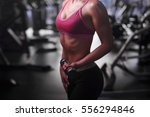 body of a young fit woman... | Shutterstock . vector #556294846