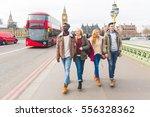 group of friends having fun in... | Shutterstock . vector #556328362