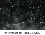 abstract bokeh on dark... | Shutterstock . vector #556334302