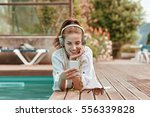 happy smartphone woman relaxing ... | Shutterstock . vector #556339828