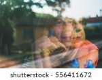 reflection in the window of a... | Shutterstock . vector #556411672