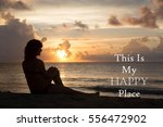 Small photo of Silhouette of a woman sitting on a beach with the inspirational message of This Is My Happy Place against a sunset background