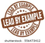 lead by example. stamp. brown... | Shutterstock .eps vector #556473412