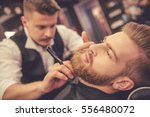 handsome bearded man is getting ... | Shutterstock . vector #556480072