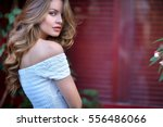 look of the sexy girl on a red... | Shutterstock . vector #556486066