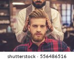 handsome bearded man is looking ... | Shutterstock . vector #556486516