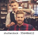 handsome bearded man is smiling ... | Shutterstock . vector #556486612