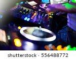 dj playing music at mixer... | Shutterstock . vector #556488772