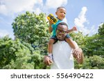 african american father and son ... | Shutterstock . vector #556490422