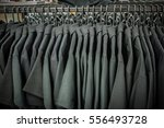 men's black polo shirts hanging | Shutterstock . vector #556493728