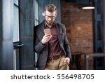 handsome caucasian businessman...   Shutterstock . vector #556498705