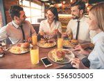 business people are eating ... | Shutterstock . vector #556505005
