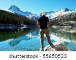 man on mountains lake | Shutterstock . vector #55650523