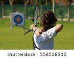 Back of archery athlete aiming...