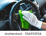 man wearing gloves to clean the ... | Shutterstock . vector #556553926