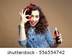 playful curly brunette holding...   Shutterstock . vector #556554742