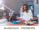 young female dressmaker... | Shutterstock . vector #556582696