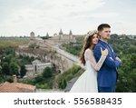 couple in love near castle | Shutterstock . vector #556588435