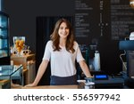 beautiful female barista... | Shutterstock . vector #556597942