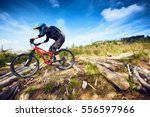 female mountain bike cyclist... | Shutterstock . vector #556597966