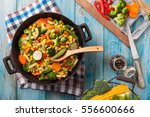 mix of vegetables fried in a... | Shutterstock . vector #556600666