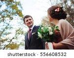 bride and groom hugging in a... | Shutterstock . vector #556608532