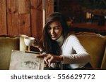 joyful girl sitting in...   Shutterstock . vector #556629772
