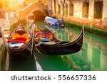 Canal With Two Gondolas In...
