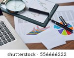 financial printed paper charts  ... | Shutterstock . vector #556666222
