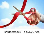 businessman cutting a red... | Shutterstock . vector #556690726