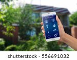 smartphone with home security... | Shutterstock . vector #556691032
