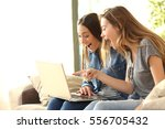 two excited roommates reading... | Shutterstock . vector #556705432
