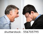 angry boss shouting to an... | Shutterstock . vector #556705795