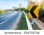 curve warning sign on the road  | Shutterstock . vector #556710736