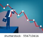 businessman looking at falling... | Shutterstock .eps vector #556713616