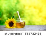 honey in jar with dipper and...   Shutterstock . vector #556732495
