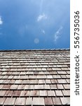 wood roof and sky | Shutterstock . vector #556735036