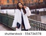 happy joyful girl in white fur...   Shutterstock . vector #556736578