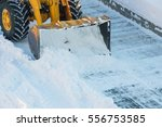 snow clearing. tractor clears... | Shutterstock . vector #556753585