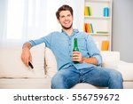 young relaxed man watching tv... | Shutterstock . vector #556759672